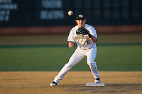 Drew Freedman (5) of the Wake Forest Demon Deacons waits for a throw at second base during infield practice prior to the game against the Georgetown Hoyas at David F. Couch Ballpark on February 19, 2016 in Winston-Salem, North Carolina.  The Demon Deacons defeated the Hoyas 3-1.  (Brian Westerholt/Four Seam Images)