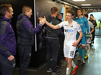 Pictured: George Byers of Swansea City is greeted by coaching staff in the tunnel after the game Monday 13 March 2017<br /> Re: Premier League 2, Swansea City U23 v Wolverhampton Wanderers FC at the Liberty Stadium, Swansea, UK