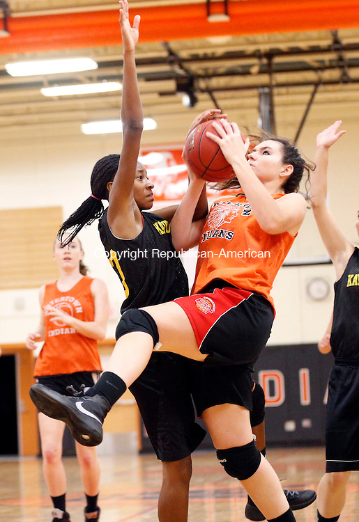 Watertown, CT- 04 December 2015-1204115CM09- Watertown's Abby Collier, drives to the hoop against Kaynor Tech's Egypt Santos during a scrimmage in Watertown on Friday.     Christopher Massa Republican-American