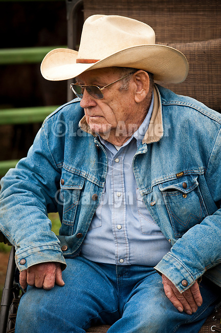 Ronnie, an old cowboy sitting and watching during the spring branding and calf marking at the Lavaggi Ranch in the Sierra Nevada Foothills near Plymouth, California..