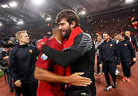 Roma s Emerson Palmieri, left, and Alisson celebrate at the end of the Italian Serie A football match between Roma and Lazio at Rome's Olympic stadium, 18 November 2017. Roma won 2-1.<br /> UPDATE IMAGES PRESS/Riccardo De Luca