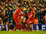 Divock Origi of Liverpool is helped back to his feet by Roberto Firmino of Liverpool - English Premier League - Liverpool vs Manchester City - Anfield Stadium - Liverpool - England - 3rd March 2016 - Picture Simon Bellis/Sportimage