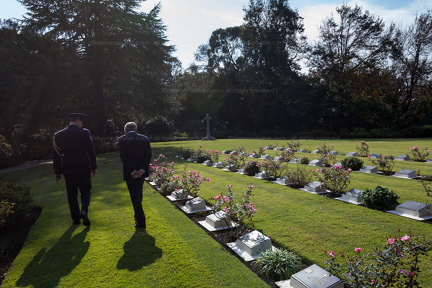 The Australian Ambassador to Japan, Richard Court inspects graves the graves of fallen servicemen and servicewomen during the Remembrance Sunday ceremony at the Hodogaya, Commonwealth War Graves Cemetery in Hodogaya, Yokohama, Kanagawa, Japan. Sunday November 11th 2018. The Hodagaya Cemetery holds the remains of more than 1500 servicemen and women, from the Commonwealth but also from Holland and the United States, who died as prisoners of war or during the Allied occupation of Japan. Each year officials from the British and Commonwealth embassies, the British Legion and the British Chamber of Commerce honour the dead at a ceremony in this beautiful cemetery. The year 2018 marks the centenary of the end of the First World War in 1918.