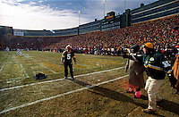 "As the NFC Championship game between the Green Bay Packers and the Carolina Panthers commences, Paul Hornung throws his jacket into the end zone and prepares to execute a Lambeau Leap on January 12, 1997. This was the first title game in Green Bay since the ""Ice Bowl"" in 1967."