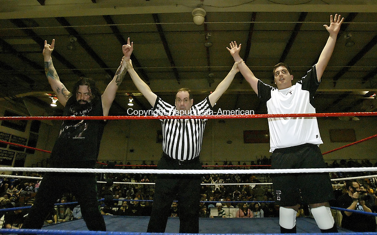 TORRINGTON, CT, 03/15/08- 031508BZ12-  Torrington Mayor Ryan Bingham, right, and his tag team partner Ron Zombie are presented to the crowd after beating Kurt Adonis and The Torrington Executioner as part of Northeast Wrestling's &quot;March Mayhem&quot; at Torrington High School Saturday night.<br /> Jamison C. Bazinet Republican-American