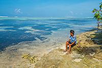 Maldives, Fenfushi Island, boy overlooking the ocean.