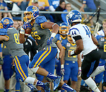 BROOKINGS, SD - OCTOBER 10:  Cam Jones #85 from South Dakota State runs upfield past Kendall Walker #44 from Indiana State in the first half of their game Saturday night at Coughlin Alumni Stadium. (Photo by Dave Eggen/Inertia)