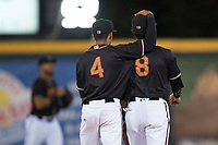 Modesto Nuts infielders Kevin Santa (4) and Bryson Brigman (8) after a California League game against the Lake Elsinore Storm at John Thurman Field on May 11, 2018 in Modesto, California. Modesto defeated Lake Elsinore 3-1. (Zachary Lucy/Four Seam Images)