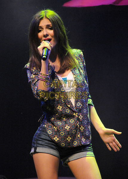 "Victoria Justice.Big Time Rush and Victoria Justice ""Summer Break Tour"" Announcement held at The House of Blues, West Hollywood, California, USA..April 1st, 2013.on stage in concert live gig performance performing music half length grey gray blue yellow blazer floral print jean denim shorts singing .CAP/ADM/BP.©Byron Purvis/AdMedia/Capital Pictures."