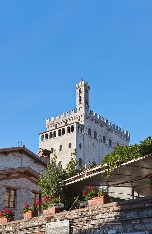 Europe, Italy, Umbria, Gubbio, Palazzo dei Consoli (Town Hall) Behind Gubbio Town