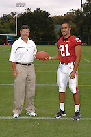 7 August 2006: Stanford Cardinal head coach Walt Harris and Thaddeus Chase during Stanford Football's Team Photo Day at Stanford Football's Practice Field in Stanford, CA.