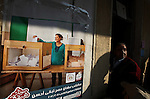 A Egyptian woman casts his vote at a polling station in the Manial neighbourhood of Cairo on November 28, 2011. Egyptians began voting in the first elections since the fall of autocrat Hosni Mubarak who was ousted in February in one of the most important moments of the Arab Spring. Photo by Wissam Nassar