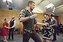 London, UK. 23.02.2015. A Lindy Hop dance class is held at Portcullis House, Westminster, hosted by DanceUK, with MPs as guests, to launch the Dance Manifesto.  Strictly's Jenny Thomas and Robin Windsor teach the class, whilst Bic Graham, from The Lindy Club,  DJs. Picture shows: Jenny Thomas & Robin Windsor (Strictly Come Dancing Choreographers) teaching some basic steps. Photograph © Jane Hobson.