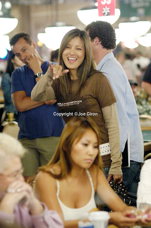 Actress Kelly Hu waves to fellow actress, Mimi Rogers.  Hu had just busted out and Rogers was still competing.