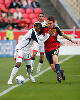 Real Salt Lake Midfielder Will Johnson (8) fights to keep the ball from New England Revolution Midfielder Sainey Nyassi (31) in the Real Salt Lake 6-0 win over New England Revolution, April 25, 2009 at Rio Tinto Stadium in Sandy, Utah.