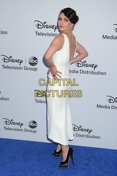 Emilie de Ravin.Disney Media Networks International Upfronts 2013 held at Walt Disney Studios, Burbank, California, USA..May 19th, 2013.full length white sleeveless dress hands on hips black shoes looking over shoulder   .CAP/ADM/BP.©Byron Purvis/AdMedia/Capital Pictures