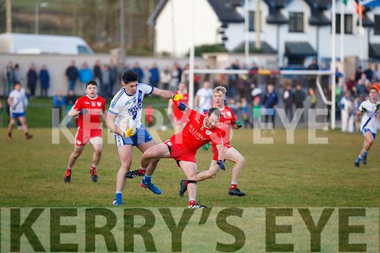 Waterville's Fergal Cronin bounces off St Marys Jack Daly.