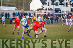 Waterville's Fergal Cronin bounces off St Marys Jack Daly.