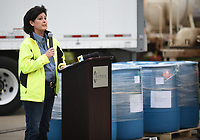 Melissa Hanesworth, of Pernod Ricard USA, speaks Friday, March 20, 2020, about the newly produced hand sanitizer at the facility in Fort Smith. As of Friday, the company is using its Fort Smith facility to produce and donate hand sanitizer to address supply shortages and help meet national needs as a response to the covid-19 virus. Check out nwaonline.com/2003221aily/ and nwadg.com/photos for a photo gallery.<br /> (NWA Democrat-Gazette/David Gottschalk)