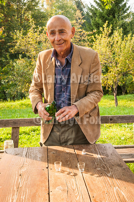 Artist--Vaso Djuricic offers Slivovitz,  near Kremna in Tara National Park, Serbia