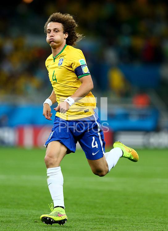 David Luiz of Brazil puffs out his cheeks as he runs
