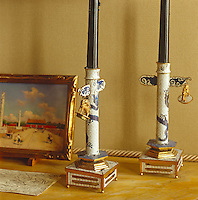 A detail highlighting a pair of exquisite 19th century Chinese candlesticks displayed on the study mantelpiece next to a miniature landscape of Tianenmen Square