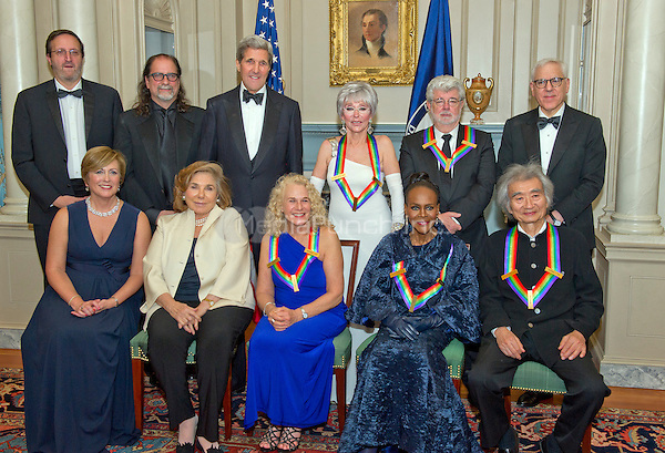 The five recipients of the 38th Annual Kennedy Center Honors pose for a group photo following a dinner hosted by United States Secretary of State John F. Kerry in their honor at the U.S. Department of State in Washington, D.C. on Saturday, December 5, 2015.  The 2015 honorees are: singer-songwriter Carole King, filmmaker George Lucas, actress and singer Rita Moreno, conductor Seiji Ozawa, and actress and Broadway star Cicely Tyson.  From left to right top: Ricky Kirshner; Glenn Weiss; United States Secretary of State John Kerry; Rita Moreno; George Lucas; and David M. Rubenstein, Chairman, John F. Kennedy Center for the Performing Arts.  From left to right bottom: Deborah F. Rutter, President, John F. Kennedy Center for the Performing Arts; Teresa Heinz-Kerry; Carole King; Cicely Tyson; and Seiji Ozawa.<br /> Credit: Ron Sachs / Pool via CNP/MediaPunch