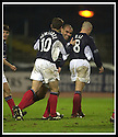 23/11/2002                   Copyright Pic : James Stewart.File Name : stewart-dundee v utd18.HENANDEZ (CENTRE) IS CONGRATULATED BY NEMSADZE AND RAE AFTER SCORING THE THIRD........Payments to :-.James Stewart Photo Agency, 19 Carronlea Drive, Falkirk. FK2 8DN      Vat Reg No. 607 6932 25.Office     : +44 (0)1324 570906     .Mobile  : +44 (0)7721 416997.Fax         :  +44 (0)1324 570906.E-mail  :  jim@jspa.co.uk.If you require further information then contact Jim Stewart on any of the numbers above.........