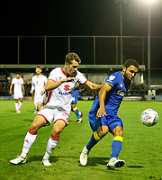 AFC Wimbledon's Andy Barchan is pressured by Milton Keynes' Callum Brittain during the Sky Bet League 1 match between AFC Wimbledon and MK Dons at the Cherry Red Records Stadium, Kingston, England on 22 September 2017. Photo by Carlton Myrie / PRiME Media Images.
