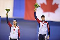 SPEEDSKATING: CALGARY: 14-11-2015, Olympic Oval, ISU World Cup, Podium Ladies 1000m, Brittany Bowe (USA), Heather Richardson (USA), ©foto Martin de Jong