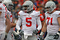 Ohio State Buckeyes quarterback Braxton Miller (5) confers with his teammates at the end of  the first quarter of their game at Memorial Stadium in Champaign, Ill on November 16, 2013. (Columbus Dispatch photo by Brooke LaValley)