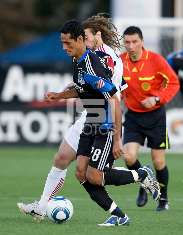 Andre Luiz of Earthquakes dribbles the ball away from Kyle Beckerman of Real Salt Lake during the game at Buck Shaw Stadium in Santa Clara, California on March 27th, 2010.   Real Salt Lake defeated San Jose Earthquakes, 3-0.