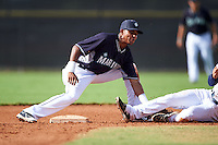 Seattle Mariners Erick Mejia (3) tags a runner out during an instructional league intrasquad game on October 6, 2015 at the Peoria Sports Complex in Peoria, Arizona.  (Mike Janes/Four Seam Images)