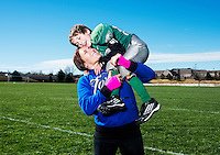 MMA fighter Cat Zingano (cq) and her son, Brayden Zingano (cq, age 8) in Parker, Colorado, Saturday, November 8, 2014. In 2013, Zingano became the first woman to win a UFC fight by technical knockout and is currently the number three ranked pound-for-pound female MMA fighter in the world.<br /> <br /> Photo by Matt Nager