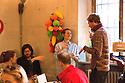 Ambra Medda (centre) creative director, speaks with a journalist during a breakfast at Ristorante Marta, in the corner with glasses, Zebedee Helm illustrator, garlands hanging on the wall by Bethan Laura Wood, Milan April 12, 2016. At this restaurant Airbnb have organized Makers &amp; Bakers and curated by Ambra Medda where the press can meet young design talent. &copy; Carlo Cerchioli<br /> <br /> Ambra Medda (centro), dirattore creativo, parla con alcuni giornalisti durante una colazione al ristorante Marta, nell'angolo con gli occhiali, l'illustratore Zebedee Helm, appese al muro ghirlande di Bethan Laura Wood, Milano 12 aprile, 2016.  In questo ristorante Airbnb ha organizzato Makers &amp; Bakers una installazione esperienziale curata da Ambra Medda dove la stampa pu&ograve; incontrare alcuni giovani talenti del design internazionale.