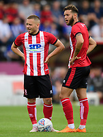 Lincoln City's Jack Payne, left, and Lincoln City's Jorge Grant<br /> <br /> Photographer Chris Vaughan/CameraSport<br /> <br /> Football Pre-Season Friendly - Lincoln City v Sheffield Wednesday - Saturday July 13th 2019 - Sincil Bank - Lincoln<br /> <br /> World Copyright © 2019 CameraSport. All rights reserved. 43 Linden Ave. Countesthorpe. Leicester. England. LE8 5PG - Tel: +44 (0) 116 277 4147 - admin@camerasport.com - www.camerasport.com
