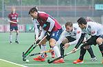 AMSTELVEEN - Nicolas Santiago Keenan (HCKZ) met Mirco Pruyser (Adam) tijdens de hoofdklasse competitiewedstrijd mannen, Amsterdam-HCKC (1-0).  COPYRIGHT KOEN SUYK