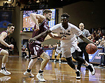SIOUX FALLS, SD: MARCH 23: Matt Bingaya #2 from Fairmont State looks to drive past Rusty Troutman #5 from Bellarmine during the Men's Division II Basketball Championship Tournament on March 23, 2017 at the Sanford Pentagon in Sioux Falls, SD. (Photo by Dick Carlson/Inertia)