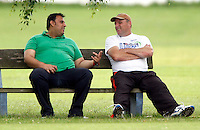 Syed Karrar and Tony Duckett in discussion during the Middlesex County League Division two game between Highgate and Harrow at Park Road, Crouch End on Sat Jun 25, 2011