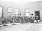 The Chama engine house crew poses for a photo in front of their workplace. Keeping a steam locomotive running is no small task, and it is something one man cannot tackle alone. Whole crews were tasked with caring for the iron horses, a never-ending and back-breaking job of constant maintenance. Today, Rio Grande engines are still serviced in the same building on the C&amp;TS.<br /> D&amp;RGW  Chama, NM