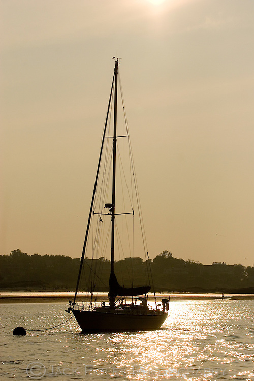 Sailboat at rest on the Annisquam River at low tide.