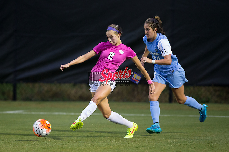 Madison Baumgardner (2) of the Wake Forest Demon Deacons passes the ball away from Sarah Ashley Firstenberg (54) of the North Carolina Tar Heels during second half action at Spry Soccer Stadium on September 27, 2015 in Winston-Salem, North Carolina.  The Tar Heels defeated the Demon Deacons 1-0.  (Brian Westerholt/Sports On Film)