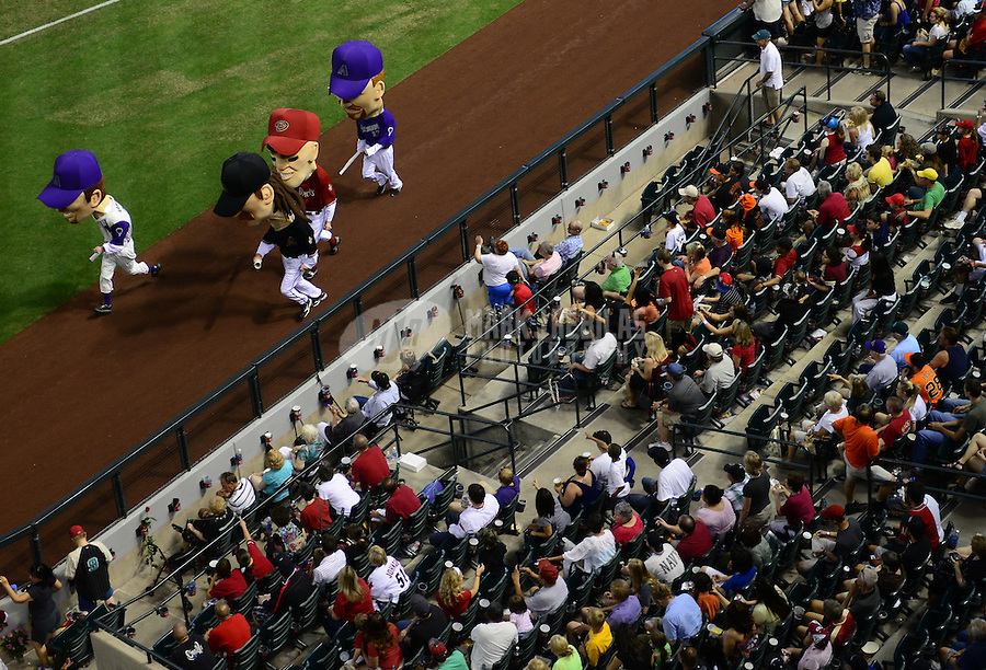 May 13, 2012; Phoenix, AZ, USA; The crowd looks on during the Arizona Diamondbacks legends race between innings of the game against the San Francisco Giants at Chase Field. Mandatory Credit: Mark J. Rebilas-