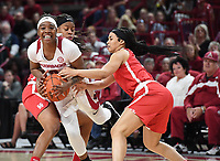 NWA Democrat-Gazette/J.T. WAMPLER Arkansas' A'Tyanna Gaulden tries to get past Houston's Octavia Barnes (LEFT) and Dymond Gladney Thursday March 21, 2019 at Bud Walton Arena in Fayetteville during the first round of the Women's National Invitational Tournament.