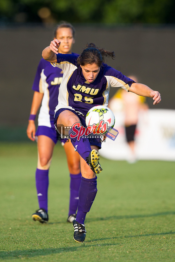 Shannon Rano (25) of the James Madison Dukes clears the ball during second half action against the Wake Forest Demon Deacons at Spry Soccer Stadium on August 29, 2014 in Winston-Salem, North Carolina.  The Dukes defeated the Demon Deacons 2-1.   (Brian Westerholt/Sports On Film)