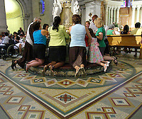 People pray to the shrine to Ste.Anne before the Cardinal Marc Ouellet farewell Mass in Sainte-Anne-de-Beaupre Basilica, 45 minutes East of Quebec City, August 15 2010. Cardinal Ouellet leaves Quebec for Vatican, as we was recently named Prefect of the Congregation for Bishops and President of the Pontifical Commission for Latin America.