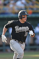 Nick Torres #10 of the Cal Poly Mustangs runs the bases during a game against the UCLA Bruins at Jackie Robinson Stadium on February 22, 2014 in Los Angeles, California. Cal Poly defeated UCLA, 8-0. (Larry Goren/Four Seam Images)