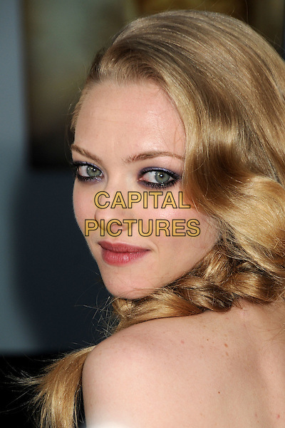 """AMANDA SEYFRIED.Attending """"Letters To Juliet"""" Los Angeles Premiere held at Grauman's Chinese Theatre, Hollywood, California , USA, .11th May 2010..arrivals portrait headshot  make-up  beauty strapless blue purple eyeshadow side profile looking back over shoulder stud earring plait fishtail braid .CAP/ADM/BP.©Byron Purvis/AdMedia/Capital Pictures."""