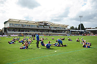 The Bath Rugby team stretch during the pre-match warm-up. West Country Challenge Cup match, between Gloucester Rugby and Bath Rugby on September 13, 2015 at the Memorial Stadium in Bristol, England. Photo by: Patrick Khachfe / Onside Images