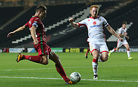 Angel Rangel of Swansea City is marked by Dean Lewington of MK Dons during the Carabao Cup Second Round match between MK Dons and Swansea City at StadiumMK, Milton Keynes, England, UK. 22 August 2017